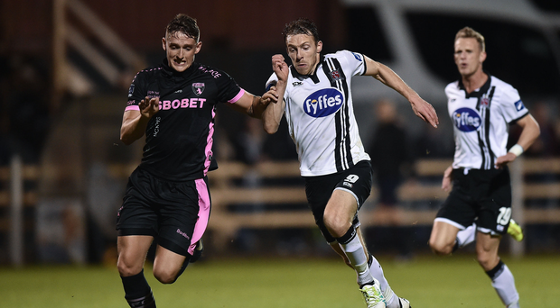 David McMillan in action against Lee Grace Photo by David Maher/Sportsfile