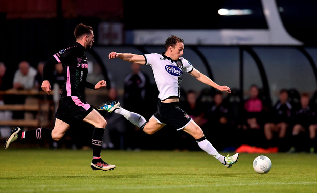 David McMillan shoots to score his side's first goal Photo by David Maher/Sportsfile