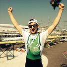 Paul O'Donovan celebrates with his gold medal