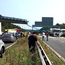 Emergency services at the scene where a footbridge collapsed on the M20 on 27 August (Natasha Najm/EPA)