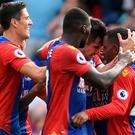 Crystal Palace's Scott Dann celebrates scoring their first goal with teammates