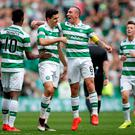 Celtic's Tom Rogic celebrates scoring his side's fourth goal