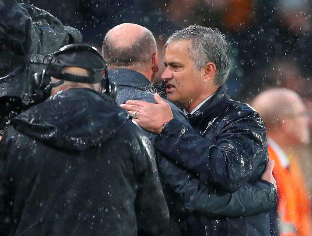 Manchester United manager Jose Mourinho and Hull City caretaker manager Mike Phelan at the end of the game