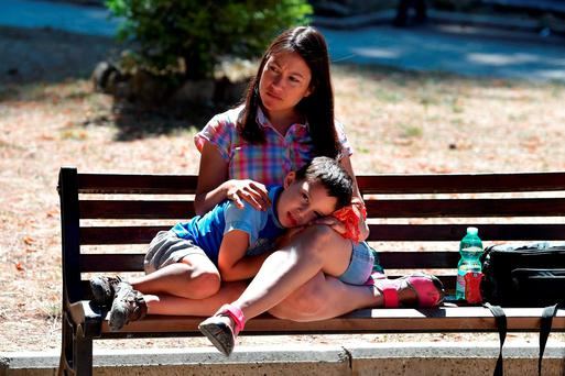 AFTERMATH: A woman and child sit on a bench in the centre of Amatrice, Italy, in the wake of last Wednesday's earthquake. (Photo by Carl Court/Getty Images)