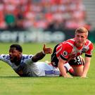 Sunderland's Jeremain Lens appeals for a foul after being challenged by Southampton's Matt Targett. Photo: John Walton