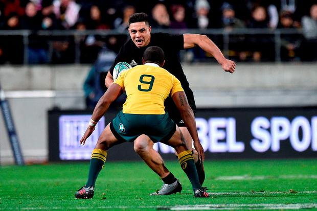 New Zealand's Anton Lienert-Brown faces Australia's Will Genia. Photo: Marty Melville/AFP/Getty Images