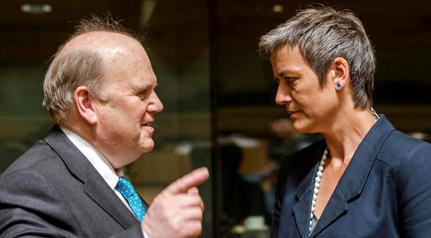 WOMAN ON A MISSION: Finance Minister Michael Noonan talks to EU Competition Commissioner Margrethe Vestager, who is investigating whether Apple's tax dealings in this country breached state aid rules. Photo: AP Photo/Geert Vanden Wijngaert