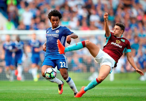 Burnley's Matthew Lowton (right) and Chelsea's Willian (left) battle for the ball. Photo: Nick Potts