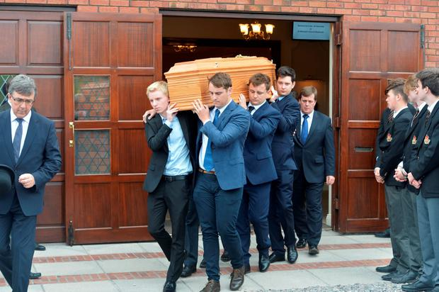 FAMILY: The coffin of Peter Barry is carried by his grandsons from O'Connor's funeral home, Temple Hill, Cork, to St Michael's Church, Blackrock. Photo: Michael MacSweeney