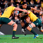 New Zealand's Malakai Fekitoa is tackled by Australia's Dean Mumm and Kane Douglas, who was alleged to have been eye-gouged by All Black Owen Franks. AFP PHOTO / Marty MelvilleMARTY MELVILLE/AFP/Getty Images