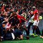 Manchester United's Marouane Fellaini helps a woman being crushed by hoarding during goal celebrations against Hull. Action Images via Reuters / Lee Smith
