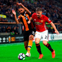 Ahmed Elmohamady of Hull City and Luke Shaw of Manchester United battle for possession. (Photo by Matthew Lewis/Getty Images)