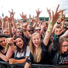 Festival goers enjoy the Leeds Festival at Bramham Park, West Yorkshire