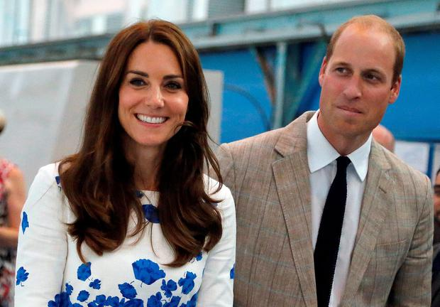 Britain's Catherine, Duchess of Cambridge, and Prince William laugh during a visit and opening of the Centre of Excellence for Hayward Tyler in Luton, England. Picture: REUTERS/Frank Augstein/Pool