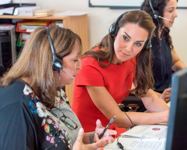 The Duchess of Cambridge (centre) listens in to real calls during a visit to YoungMinds in London, a helpline service run by one of the eight charity partners of their Heads Together mental health campaign. Picture: Arthur Edwards/The Sun/PA Wire