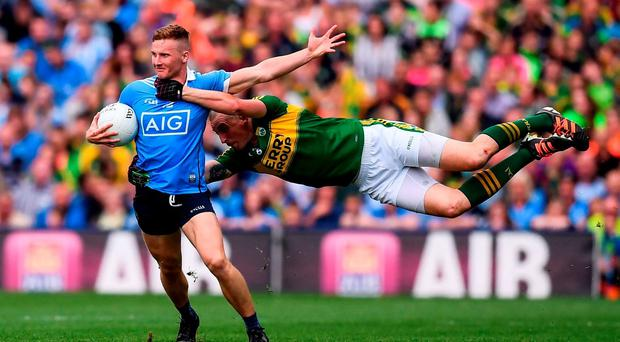 Ciarán Kilkenny of Dublin in action against Kieran Donaghy of Kerry during the GAA Football All-Ireland Senior Championship Semi-Final match between Dublin and Kerry at Croke Park in Dublin. Photo by Stephen McCarthy/Sportsfile
