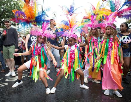 Dancers perform during the Children's Day parade at the Notting Hill Carnival in west London Credit: Isabel Infantes/PA Wire
