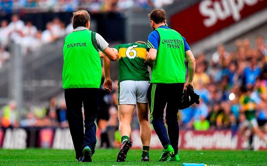 Peter Crowley of Kerry is attended to by team doctor Mike Finnerty, left, and physio John Sugrue after a clash with Kevin McManamon of Dublin during the GAA Football All-Ireland Senior Championship Semi-Final game between Dublin and Kerry at Croke Park in Dublin. Photo by Brendan Moran/Sportsfile