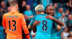 Manchester City's Raheem Sterling (right) celebrates with team-mate Samir Nasri after the final whistle following the Premier League match at the Etihad Stadium