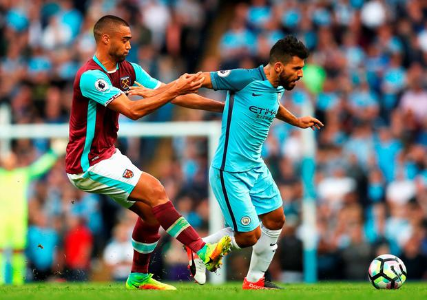 Sergio Aguero of Manchester City is challenged by Winston Reid of West Ham United. Photo: Getty