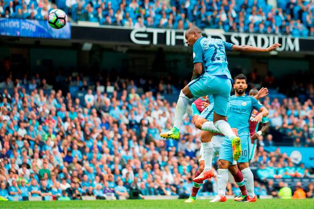 Manchester City midfielder Fernandinho jumps to head in their second goal. Photo: Getty