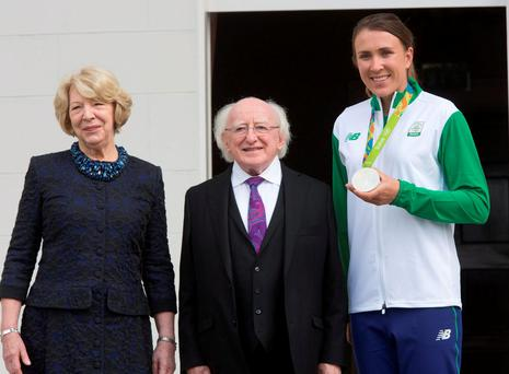 Sailing silver medallist Annalise Murphy with President Michael D Higgins and his wife Sabina. Photo: Colin O'Riordan