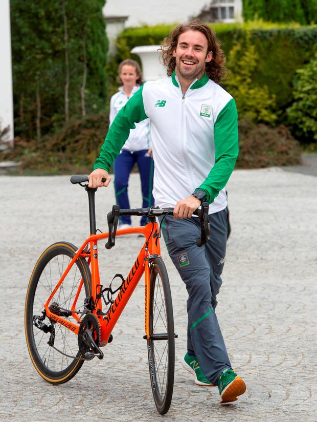 Triathelete Bryan Keane arrives by bicycle. Photo: Colin O'Riordan