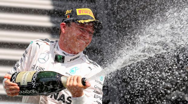 Nico Rosberg celebrates his victory in Belgium. Photo: Reuters