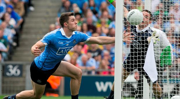 Dublin's Davey Byrne and Stephen Cluxton scramble in vain to keep Kerrys Paul Geaney's effort out