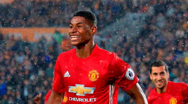 Marcus Rashford celebrates after scoring the winner for Manchester United. Photo: Getty Images