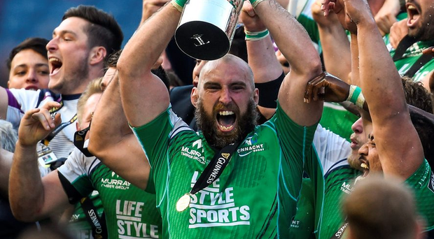 Connacht captain John Muldoon collects the Pro12 trophy last season. The competition is in its 16th season and still struggling to shed its reputation as a second-class product. Photo: Ramsey Cardy/Sportsfile