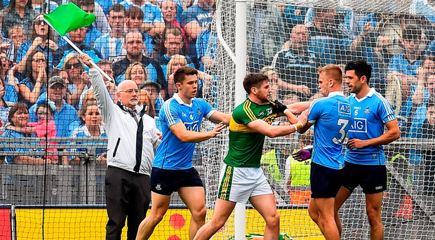Dublin and Kerry players exchange views after Darran O'Sullivan's opening goal. Photo: Sportsfile