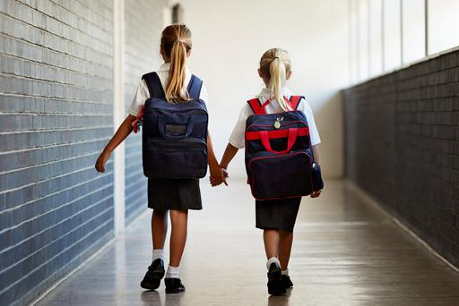 Overloaded school bags are leaving youngsters at risk of back pain and poor posture. Photo: Getty