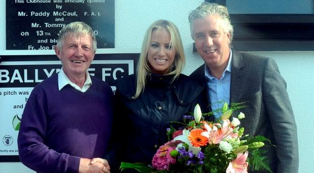 Padraig Grogan of Ballymoe FC with FAI chief John Delaney and partner Emma English at the official opening of the club's redeveloped pitch.