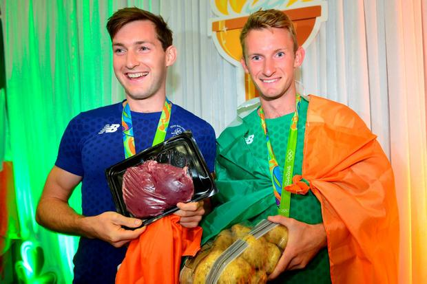 Olympic heroes Gary and Paul O'Donovan pose with 'steak and spuds' after they arrived at Cork Airport last night. Pic Michael Mac Sweeney/Provision