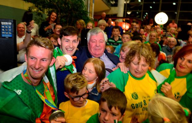 The O'Donovan brothers show their medals as they are greeted by crowds of fans at Cork Airport. Pic Michael Mac Sweeney/Provision