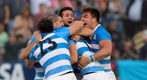 Argentina's Los Pumas rugby players celebrate after defeating South Africa by 26-24. Photo: Getty