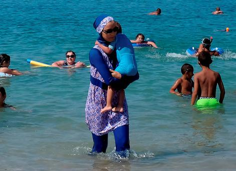 A woman wearing a burkini at a beach in Marseille after the ban was suspended. Photo: Reuters