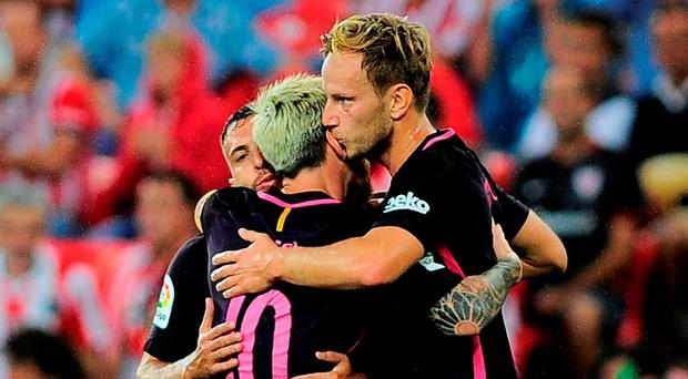 Barcelona's Croatian midfielder Ivan Rakitic (R) is congratulated by teammates. Photo Getty