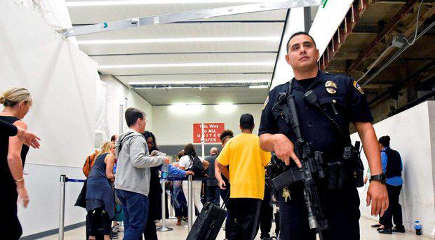 Chaos at LAX airport after reports of gunfire