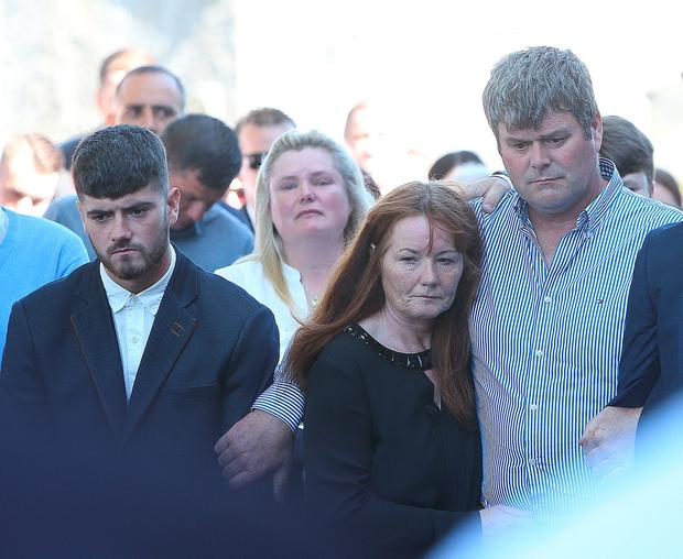 Family members look on as The coffin is carried to St Anne's church, Bohernabreena for the funeral mass of Daniel Sheridan. Picture credit; Damien Eagers 29/8/2016