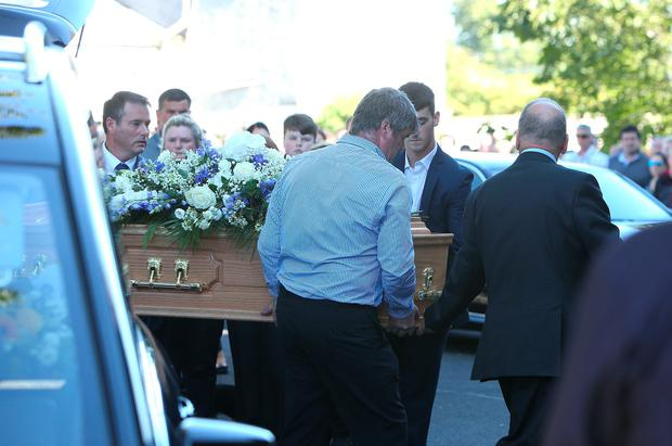 The coffin is carried to the church for the funeral mass of Daniel Sheridan at St Anne's church, Bohernabreena Picture credit; Damien Eagers 29/8/2016
