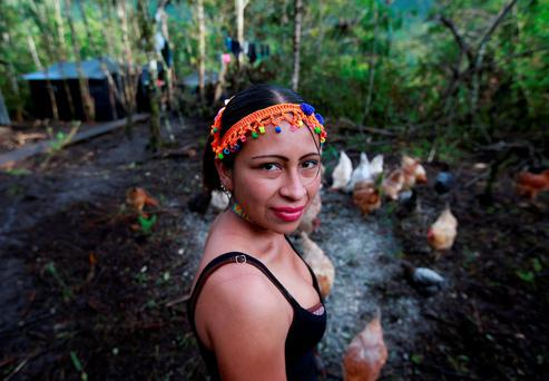 Patricia, a member of the 51st Front of the Revolutionary Armed Forces of Colombia (FARC), poses for a picture at a camp in Cordillera Oriental, Colombia, August 16, 2016. Picture taken August 16, 2016