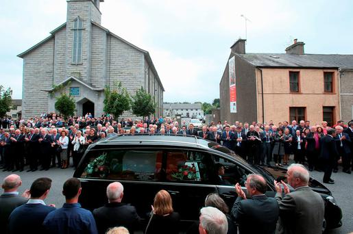 The coffin of Anglo Irish Agreement deal-maker and former Tanaiste Peter Barry is brought from St Michael's Church, Blackrock, Cork. Photo: Brian Lawless/PA Wire