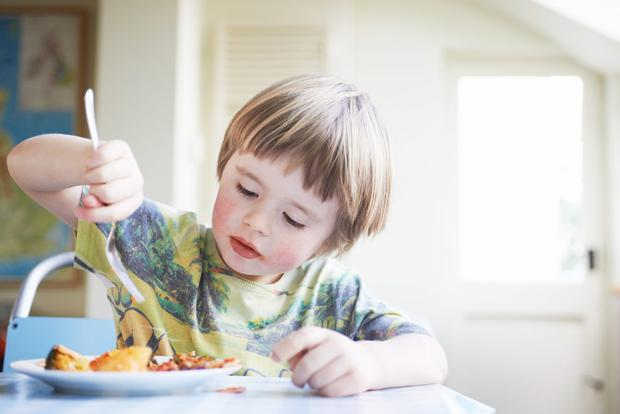 Parents are increasing their children's chances of being overweight or obese by serving them up adult-sized portions of popular meals. Stock Image: GETTY