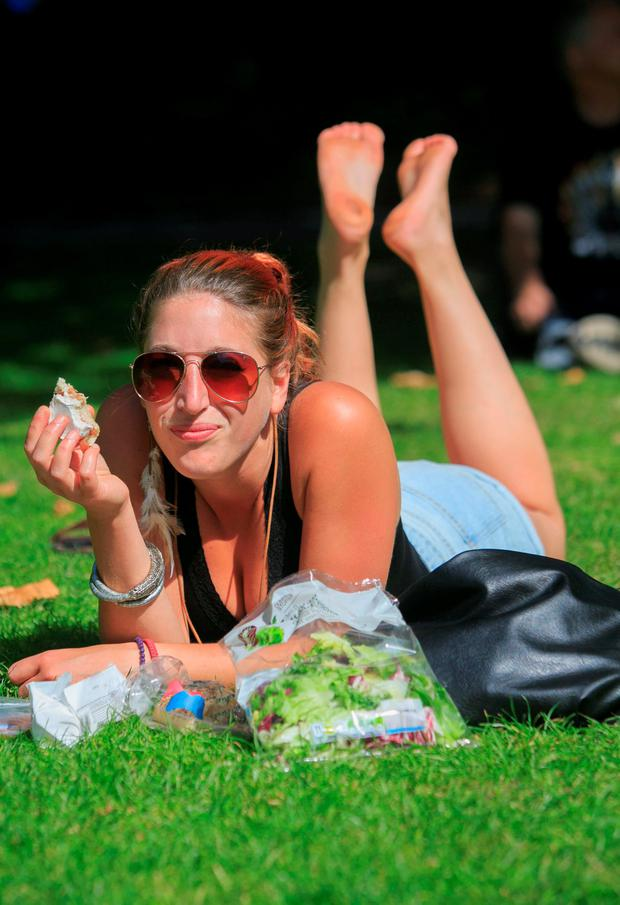 Anick Sitruk from Holland enjoying the good weather in St. Stephens Green, Dublin. Photo: Gareth Chaney Collins