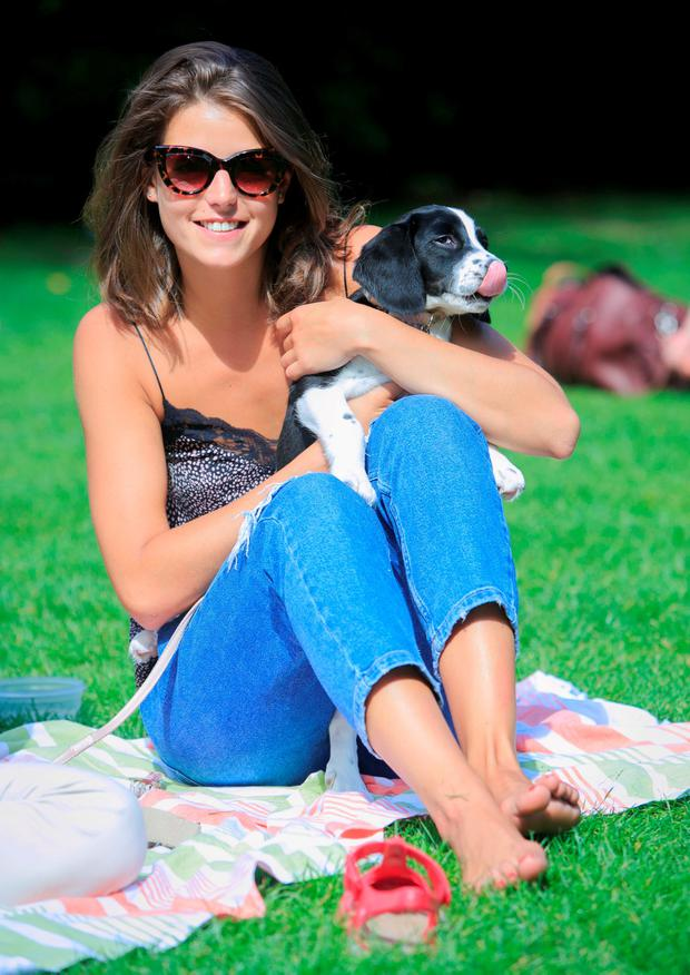 Alex Monedero from Capel St with her dog Millie enjoying the good weather in St. Stephens Green, Dublin. Photo: Gareth Chaney Collins