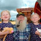 Bobby Tighe from Ryfield, Virginia, Co Cavan with His granddaughters Aleigh and Alannah Mc Namee from Dublin, who were at Girley Harvest Festival in Co Meath Pic Seamus Farrelly