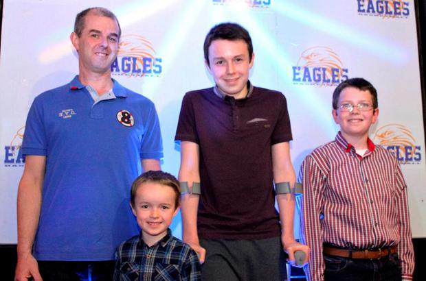 Alan Hawe with his sons Liam (13), Niall (11) and Ryan (6)