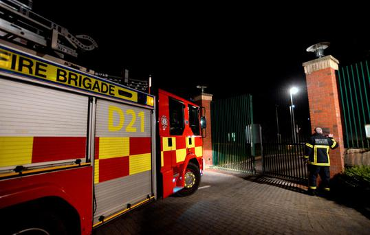 A fire engine arrives at the gates of the Oberstown facility in north Co Dublin last night. Picture; Caroline Quinn